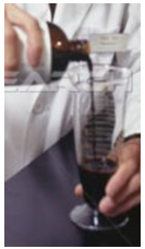 Figure 12: Measurement by pouring medicine into a beaker. This in itself is a predictive computation: how many days worth of medicine are provided?