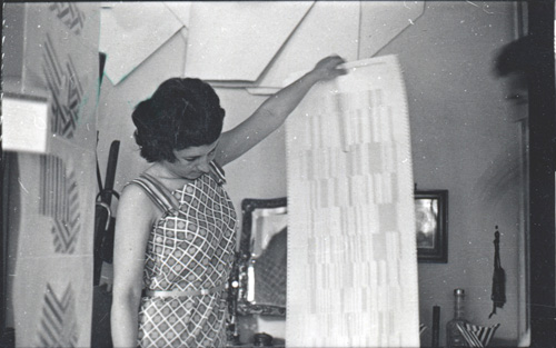 Fig. 7. Letitzia Bucur, a very talented painter in her own right, examines what her husband, Serban Epuré, was working at during those years (ca. 1972)(© Mihai Nadin)